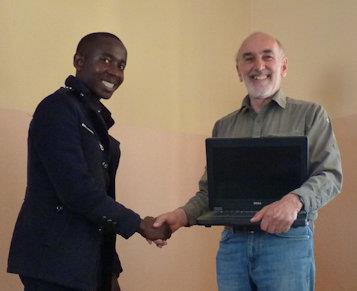 Handover of a laptop to an ex bursary student
